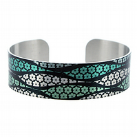 Artistic jewellery cuff bracelet, brushed silver, green with black daisies. B280