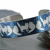 Cat jewellery cuff bracelet, blue with brushed silver cats or kittens. B386