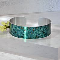 Artistic jewellery bracelet,handmade metal cuff with teal floral design. B137