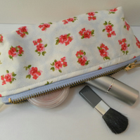 Small make up bag,  pretty floral cotton fabric, light blue background