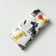 Glasses, sunglasses case, dogs on white background
