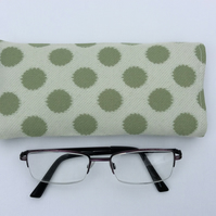 Sunglasses, glasses case, pouch, cream with large green dots