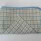 Zipped case, sewing notions, short knitting needles, crochet hooks.