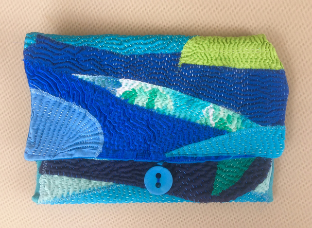 Envelope clutch in shades of blue and green, handbag