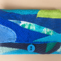 Envelope clutch in shades of blue and green
