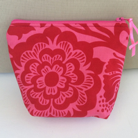 Floral Make Up Bag, Red blossoms and leaves on a pink background