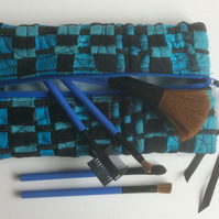 Turquoise and black, zipped, recycled woven fabric make up bag or pencil case