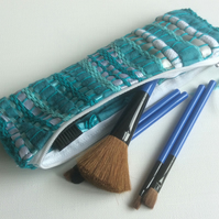 Turquoise, zipped, woven make up bag or pencil case