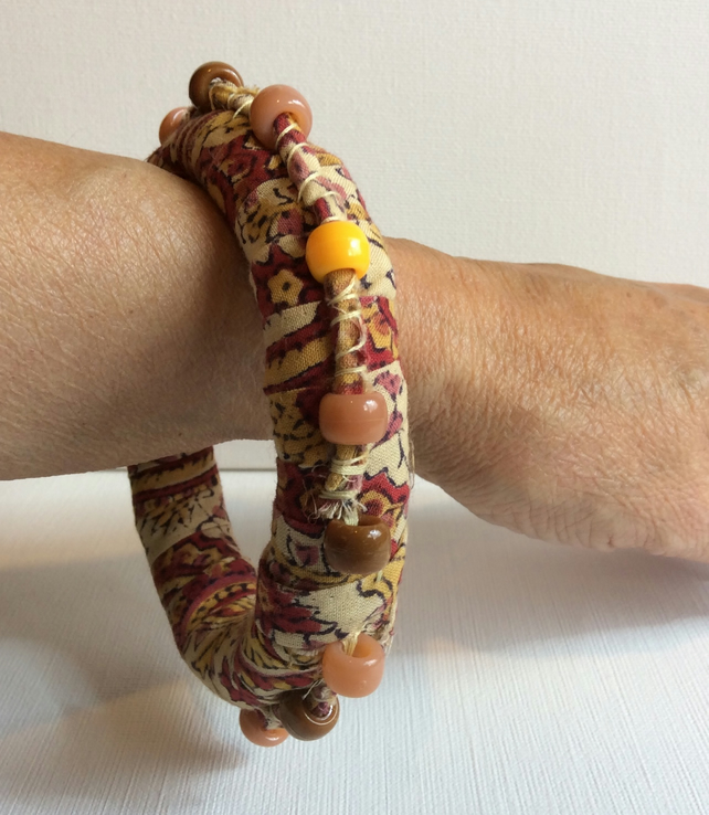 Bangle, bracelet, boho chic, fabric wrapped, slip on, peach, red with beads