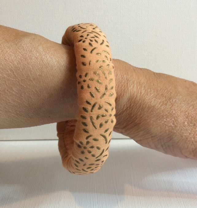 Bangle, bracelet, fabric covered, slip on, peach with gold embossed pattern