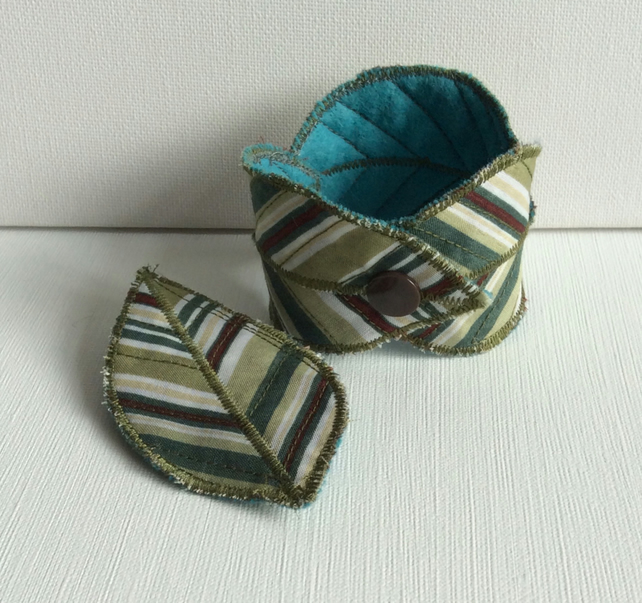 Textile, reversible bracelet and brooch, leaves