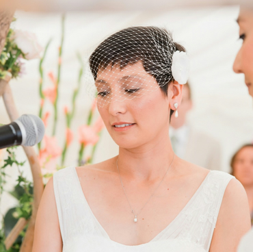 Birdcage veil with an ivory flower fascinator Bandeau style bird cage veil
