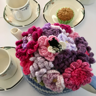 pink and purple flower crochet tea cosy