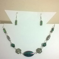 Multi shade green necklace and earring set with silver plated findings.
