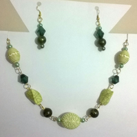 Multi shade green necklace and earrings set with gold plated findings.