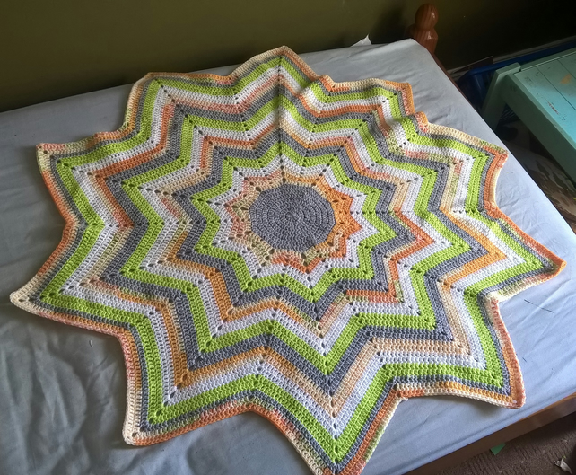 10 point star shaped blanket in grey, white, green and orange