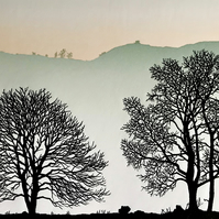 In The Valley, line of silhouetted trees, misty landscape, Devon, dawn sky