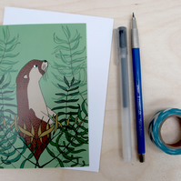 Otter and kelp greetings card