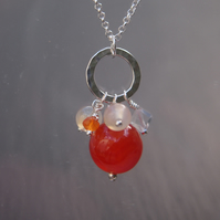 Carnelian, quartz and sterling silver chakra pendant