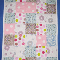Patchwork quilt for a child's cot or pram or play mat