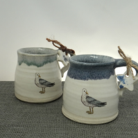 Handmade coast inspired ceramic seagull mug with sky-blue coloured rim