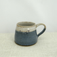 Handmade ceramic mug with lambs glazed in shades of blue and creamy white