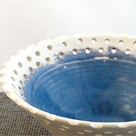 Decorative blue and white ceramic bowl with pierced rim - white earthenware
