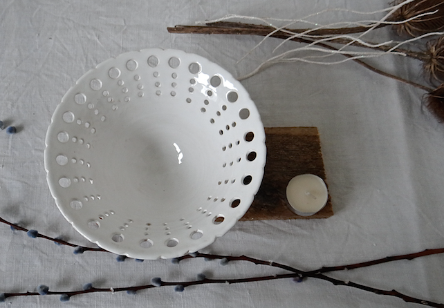 Creamy-white ceramic bowl with pierced rim - handmade stoneware pottery