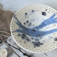 Handmade ceramic dish bowl with decorative rim in blue and white