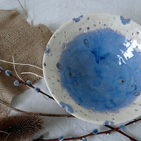 Handmade ceramic display bowl with decorative rim in blue and white