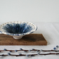 Decorative handmade ceramic dish bowl with pierced rim in blue and white