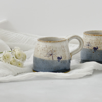 Handmade blue and white ceramic mug with running hare - stoneware pottery