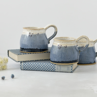Handmade ceramic blue and white mug with lambs sheep - stoneware pottery