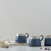 Handmade ceramic blue and white leaping hare mug - stoneware pottery