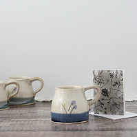 Handmade stoneware ceramic mug with flowers glazed in shades of blue and white