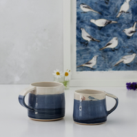 Blue and white espresso cup with bird - handmade illustrated pottery