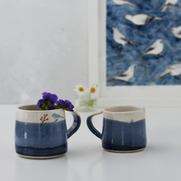 Blue and white ceramic mug with bird - handmade illustrated pottery