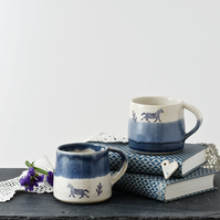 Handmade blue and white espresso cup with horse - illustrated stoneware pottery