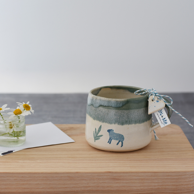Handmade green and cream ceramic mug with sheep - illustrated pottery
