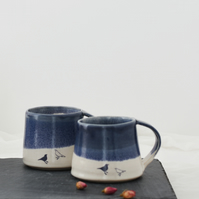 Blue and white ceramic mug with birds - handmade illustrated pottery