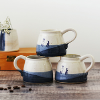 Handmade ceramic rabbit bunny mug glazed in blue and white - illustrated pottery