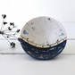 Handmade blue and white ceramic birds on a wire bowl - illustrated pottery