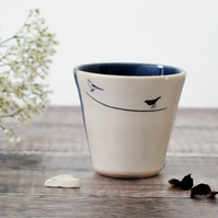 Handmade blue and white ceramic tumbler beaker cup with garden birds