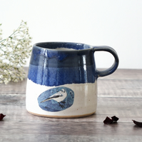 Blue and white ceramic mug with garden bird - handmade illustrated pottery