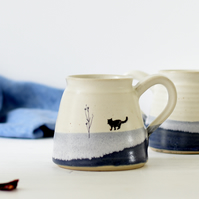 Handmade blue and white ceramic mug with cat image - stoneware pottery