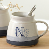 Handmade blue and white ceramic mug illustrated with letters M N P