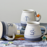 Handmade blue and white ceramic mug personalised with the letters R S T