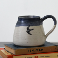 Ceramic mug with flying bird - blue and white handmade pottery