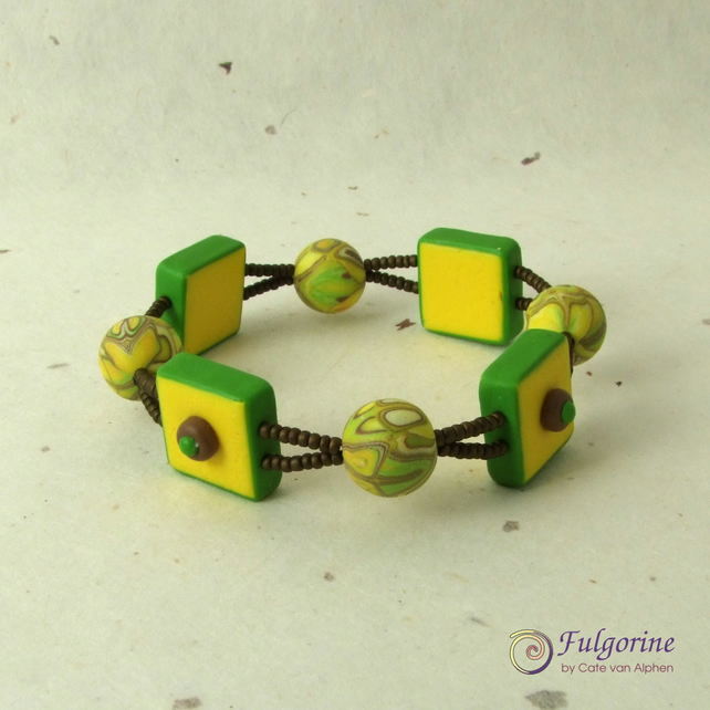 Yellow brown and green polymer clay bead stretch bracelet