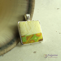 Silver and ivory pendant with yellow and green geometric pattern
